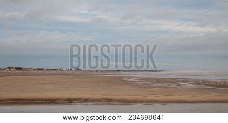 Seascape Photo Of A Sandy Beach At Low Tide