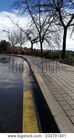 Wet Sidewalk And Asphalt Wet From The Rain