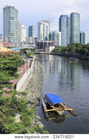 Manila - June 12: Small Passenger Ferry Boats Crossing The Pasig River From  Makati To Highrise Rock