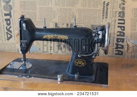Kiev, Ukraine - January 20, 2018: Old Sewing Machine Of Soviet Manufacture And Soviet Newspapers In
