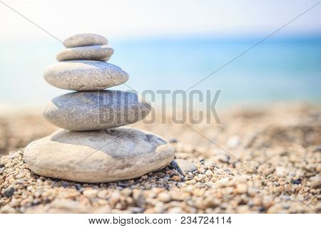 Stones Are Lined With Pyramid On Beach. Pebbles. Stones Pyramid Symbolizing Zen, Harmony, Balance On