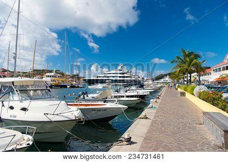 Gustavia, St.barts - January 25, 2016: Boats And Yachts Anchored At Sea Pier On Tropical Beach. Yach