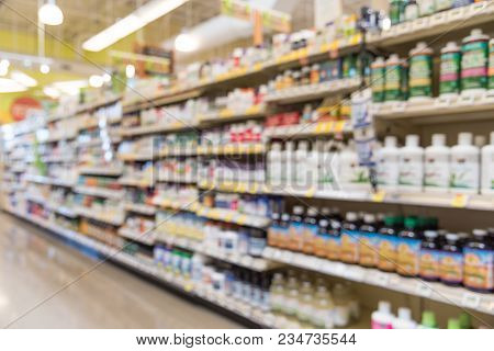 Blurred Vitamin Store Shelves Huge Variation Of Vitamins And Supplements