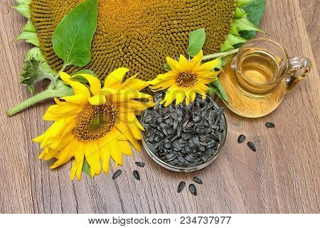 Flowers Sunflower, Seeds And Sunflower Oil. Horizontal Photo.