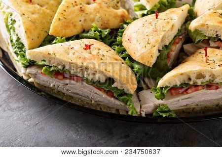 Tray Of Turkey Sandwiches Ready To Be Delivered