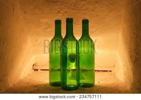 Green Wine Bottles In A Niche In An Old Castle