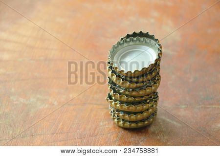 Tin Bottle Cap For Cover Beer Or Soda Arranging On Wooden Board