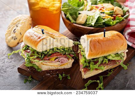 Italian Sub Sandwich With Salami, Ham And Caesar Salad