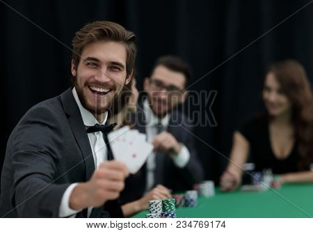 player to the casino with a combination of four aces.
