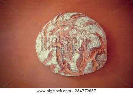 Traditional Round Rye Bread On Wooden Background. Top View.