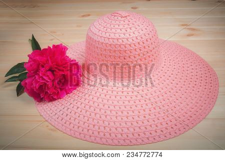 Pink Summer Hat And Red Peony Flower On Wooden Background