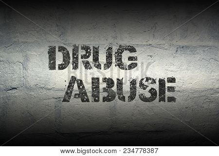 Drug Abuse Stencil Print On The Grunge White Brick Wall