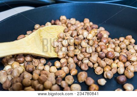 Fry Hazelnuts In A Frying Pan. Fresh Nuts In The Pan..