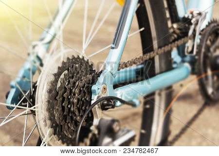 Closeup Of A Bicycle Gears Mechanism And Chain On The Rear Wheel Of Mountain Bike