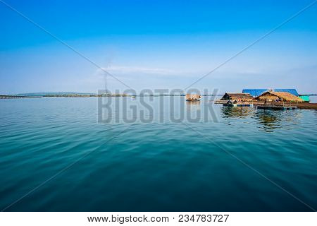 View riverside with blue skyclouds and raft in countryside poster