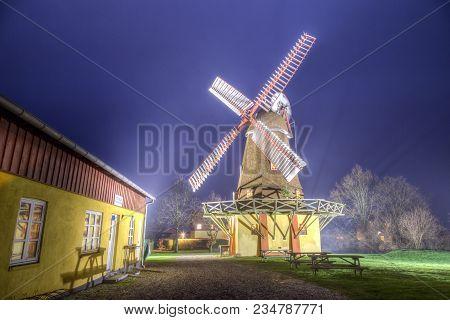 Ramloese, Denmark - December 30, 2016: Hdr Photo Of An Illuminated Historic Danish Windmill