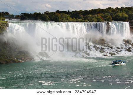 Niagara Fall Horseshoe. Ontario. Canada. Beautiful Waterfall On Blue Sky And White Clouds Background