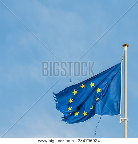 European Union Flag On A Mast Proudly Moving In The Wind Despite The Ripped Up Pieces Of Cloth On Th
