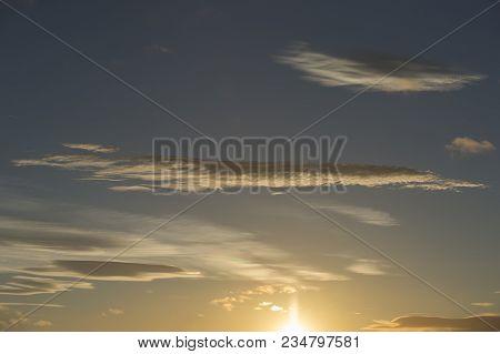 Wispy White Clouds In A Pale Blue Sky