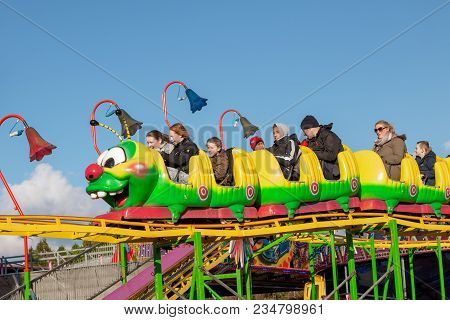 April 4th, 2018, Cork, Ireland - People Enjoying Rides At Funderland Theme Park On Tramore Road; The