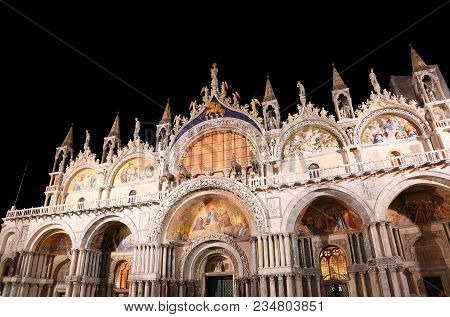 Illuminated Saint Mark Basilica With Black Sky At Night With Long Exposure In Venice Italy