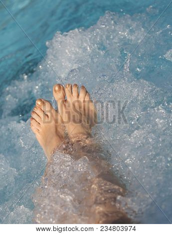 Detail Of Two Feet Of Woman During The Whirlpool Therapy In The Spa Pool