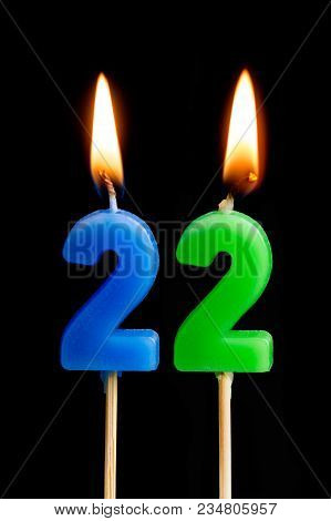 Burning Candles In The Form Of 22 Twenty Two (numbers, Dates) For Cake Isolated On Black Background.