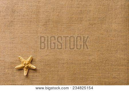Starfish On Burlap Fabric Texture Background/summer Beach Vacation Concept