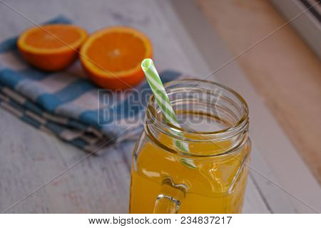 Fresh Orange Juice In A Glass And Tangerine Cutting On Wooden Background/ Food Background/ Conceptua