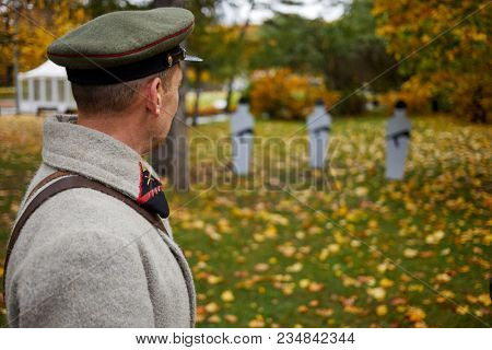 MOSCOW, RUSSIA - OCT 14, 2017: Man in uniform of russian officer looks at targets during historical reconstruction The Day of History in Sokolniki park.
