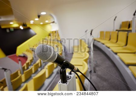 Closeup microphone in conference auditorium.