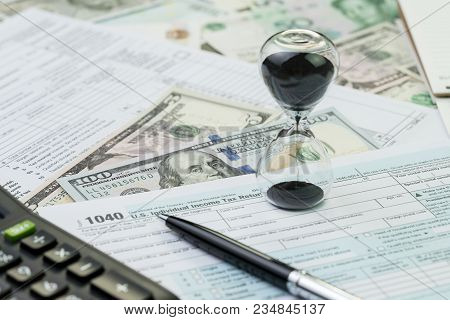Time Countdown For Tax Deadline Concept, Hourglass Or Sandglass With Pen On 1040 Us Individual Incom
