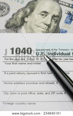 Tax Time Concept, Pen On 1040 Us Individual Income Tax Filling Form With Us Dollar Banknote, Calcula