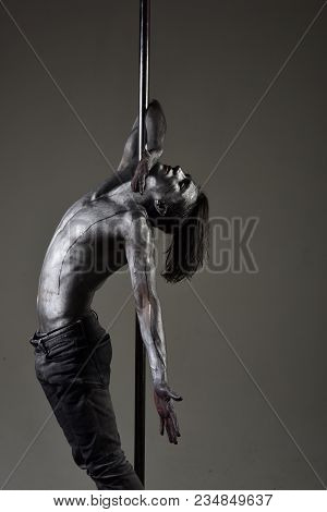 Performance Concept. Man With Nude Torso Covered With Shimmering Silver Paint, Dark Background. Athl