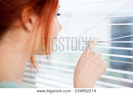 Close Up Of Woman Looking Through The Jalousie