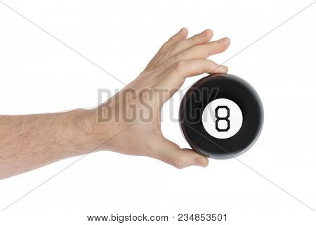 Hand with magic billiard ball number eight isolated on white background