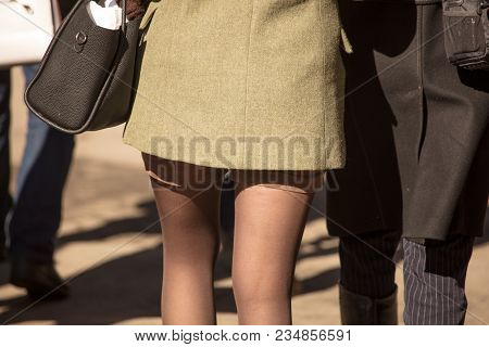 Girls In Short Shorts And Coats In The Park .