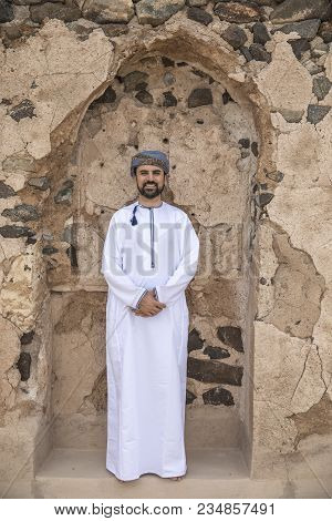 Arab Man In Omani Outfit Posing For A Camera