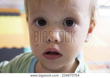 Little Serious Toddler With Big Brown Eyes