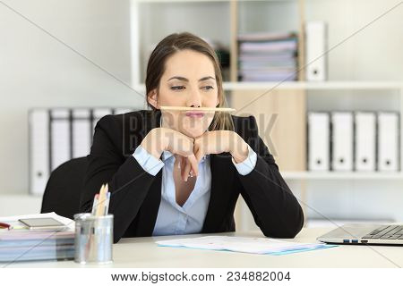 Lazy Employee Wasting Time Playing With A Pencil At Office