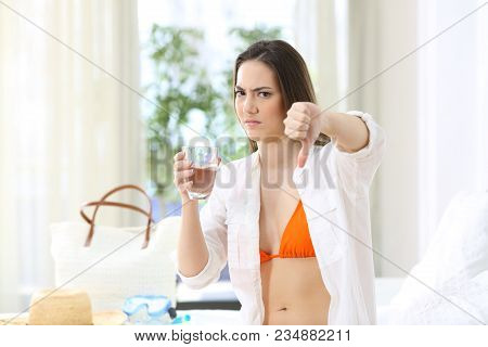 Angry Tourist Forbiding Non-potable Tap Water In An Hotel Room During A Travel On Summer Vacations