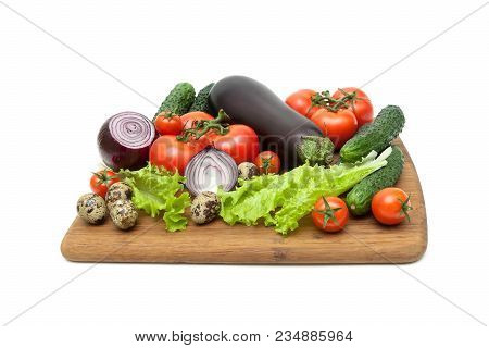 Vegetables And Quail Eggs On A Cutting Board On A White Background. Horizontal Photo.