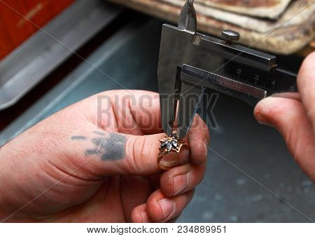 The Work Of A Jeweler. Jeweler Pulls The Gem Out Of The Ring.
