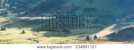 Beautiful Rural Mountain Landscape In The Morning Light With Old Houses And Haystacks, Fundatura Pon