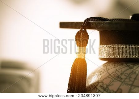 Graduate Study Abroad Concept, Graduation Cap On Top Earth Globe Model Map On Laptop With Radar Back
