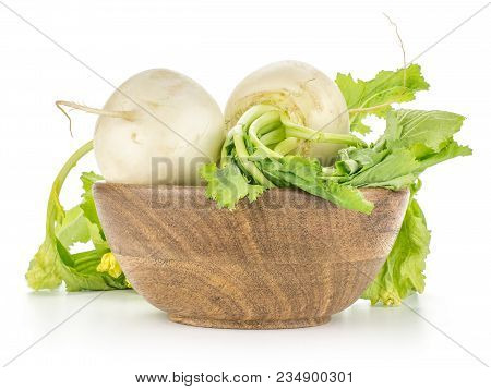 White Radish Bulbs With Fresh Leaves In A Wooden Bowl Isolated On White Background