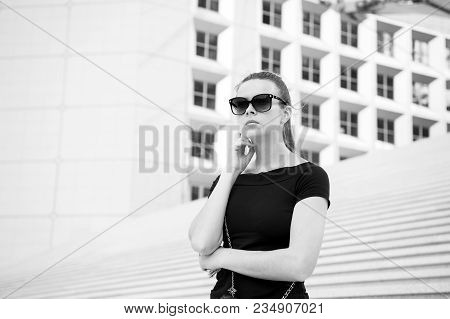 Girl In Sunglasses Posing On Concrete Stairs And Building In Paris, France. Ambitions And Success Co