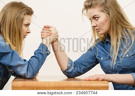 Two Serious Competetive Women Having Arm Wrestling Fight, Compete With Each Other.