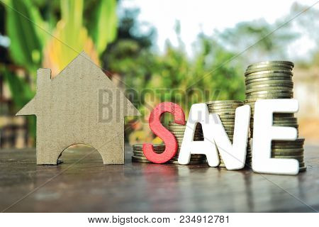 Wooden Letter Blocks Writing Word Save And Paper Cut Of Model House With Coins On Wooden Table, Save