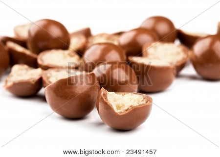 Chocolate Balls And Halves With Crisp Filling Isolated On White